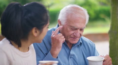 4K Caring home support worker with elderly man in the garden - stock footage