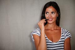 Young call center operator in casual clothing talking on headphones - copy sp - stock photo