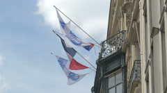 Flags on Marriott Hotel on Avenue des Champs-Elysees, Paris Stock Footage
