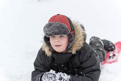 Teenage boy playing snow in winter - stock photo