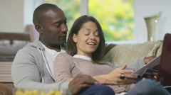 4K Relaxed couple at home, doing household accounts on the sofa Stock Footage