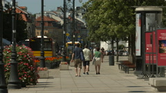Walking and driving on Krakowskie Przedmiescie street in Warsaw Stock Footage