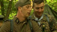 German soldiers drinking wine in foxhole Stock Footage