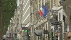 Waving flags above the Marriott Hotel entrance on Champs-Elysees, Paris Stock Footage