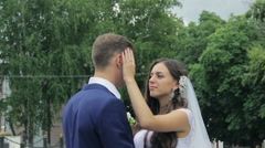 bride and groom  embracing tenderly kissing in a green park smile and happiness - stock footage