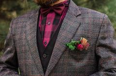 Cool Boutonniere on hip trendy groom at wedding. Grey suit, colorful vinous - stock photo