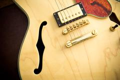 Guitar body detail with sound hole and pickup Stock Photos