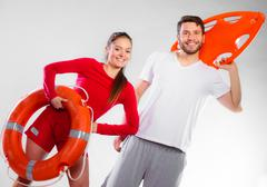 Stock Photo of lifeguard couple with rescue equipment