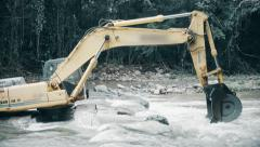 Excavator is trapped in River Stock Footage