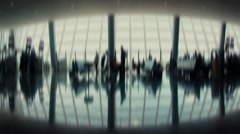 Crowd of people walking with luggage in the international airport, de-focused - stock footage