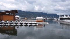 Boats in lake under cloudy sky Stock Footage