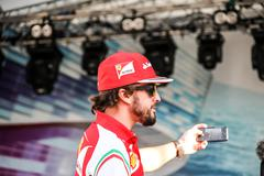 Selfie Fernando Alonso at the autograph session - stock photo