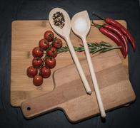 Cookware and healthy fresh ingredients on chopping board Stock Photos
