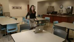 Attractive young girl in office, rushing to computer - stock footage