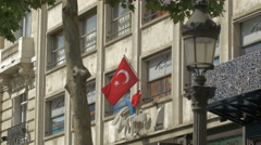 Flag of Turkey above Turquie office on Av. des Champs-Elysees, Paris Stock Footage