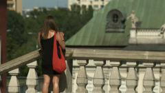 Woman on the roof of a building and taking pictures of Warsaw Stock Footage