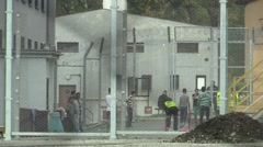 The refugees in the detention camp for razor fence Stock Footage