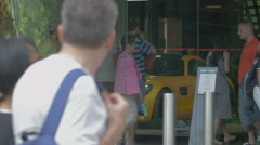 Admiring a yellow car at Mercedes Benz showroom on Av. des Champs-Elysees, Paris Stock Footage