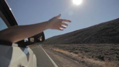 Driving, desert road, girls hand in the wind Stock Footage