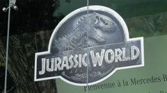 Jurassic World logo seen on Avenue des Champs-Elysees, Paris Stock Footage