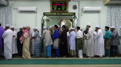 Muslims in the mosque shaking hands with one another Stock Footage