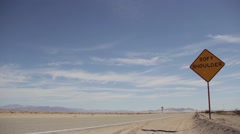 Desert road and sign, deserted, quiet Stock Footage