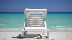 One sunbed on tropical calm beach Stock Footage