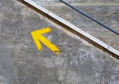 Yellow arrow sign in The Way of Saint James Stock Photos