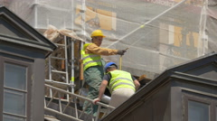 Stock Video Footage of Men working on scaffolding in Warsaw