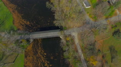 Fly-over and pull back from Fallsburg park covered wooden bridge,Michigan Stock Footage