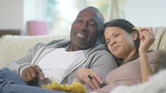 4K Attractive affectionate couple relaxing at home, watching TV - stock footage