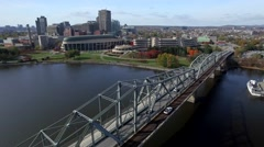 Aerial bridge reveal museam over water and city scape Stock Footage