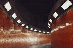 Illuminated walkway in tunnel Stock Photos
