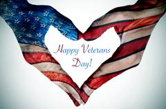 Stock Illustration of text happy veterans day and hands forming a heart with the flag of the US