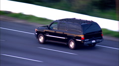 Black SUV Driving on PCH Aerial Day Stock Footage