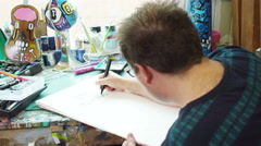 4K Modern graphic artist at work in his studio - stock footage
