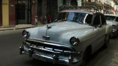 Stock Video Footage of Classic white chevy on a street in old Havana