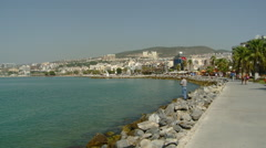 Kusadasi, Turkey - Turkish Man Fishing on the Promenade Stock Footage