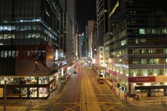 Night traffic in Des Voeux Road Central - stock photo