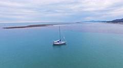 Yacht with reflection sail. Aerial view slow motion. White luxury ship in Thaila Stock Footage