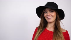 Woman in hat and red sweater. Smiling girl 4K. Stock Footage