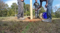 Men Digging a Post - stock footage