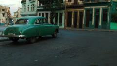 Classical car turning at the crossroad in Havana - stock footage