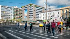 Athens - People cross the street on Omonoia square Stock Footage