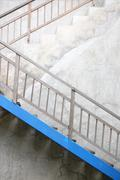 Industrial staircase against an exterior concrete wall Stock Photos
