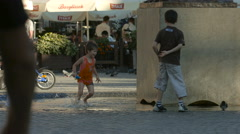 Child running in water and playing near a pedestal in Warsaw Stock Footage
