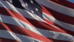 Closeup of a large American flag waving in the wind Stock Footage