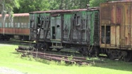 Stock Video Footage of Old Decaying Train Car In Railroad Yard-
