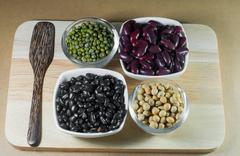 Soy beans, Red beans, black beans and green beans Stock Photos