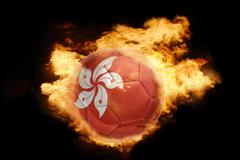 football ball with the flag of hong kong on fire - stock photo